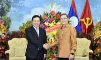 Vizepremierminister Pham Binh Minh beglückwünscht das laotische Neujahrsfest