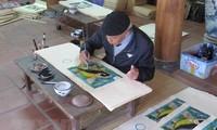Unterlagen des Berufs zur Herstellung von Dong Ho-Bildern für Unesco-Vorlage fertig stellen