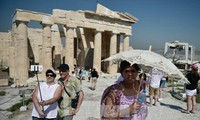 IMF approves conditional loan to Greece