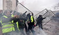 Paris police fire tear gas as yellow vest protests turn violent