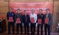 Menyosialisasikan pusaka, negeri dan manusia Vietnam di  media Laos