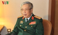 Vice Defense Minister Nguyen Chi Vinh meets Vietnamese chief representatives abroad