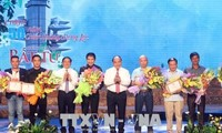 Awards given to winners of song writing contest to honor martyrs