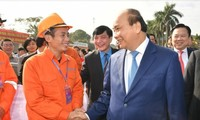 PM attends Tet program with workers, inaugurates Memorial House of Nguyen Duc Canh