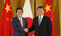 Abe, Xi vow to boost regular, close communication
