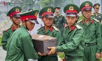 Truy điệu, an táng 12 hài cốt liệt sỹ quân tình nguyện Việt Nam hy sinh tại Lào