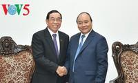阮春福会见韩国现代汽车集团总裁S.K.Han和老挝公共工程与运输部部长本占