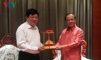 老挝新闻文化和旅游部部长波显坎•冯达拉会见本台台长阮世纪