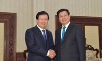 越南政府副总理郑庭勇会见老挝政府总理、国会主席