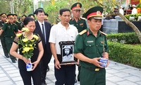 Tổ chức truy điệu, an táng hài cốt liệt sĩ quân tình nguyện và chuyên gia Việt Nam hy sinh tại Lào