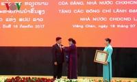 Церемония вручения орденов партии и государства Вьетнама высшим руководителям Лаоса