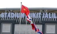 Izada de bandera nacional de los países participantes en Seagames 29 en Malasia