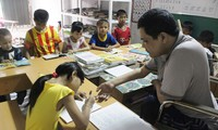 Phung Van Truong, a disabled teacher of poor students