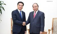 阮春福会见老挝总理府部长兼办公厅主任佩·蓬皮帕