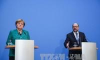 Allemagne: la CDU valide le contrat de coalition avec le SPD