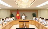 Vuong Dinh Huê dirige la réunion sur les programmes cibles nationaux