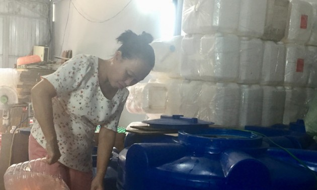 Vietnamese woman makes cleaning fluid from garbage