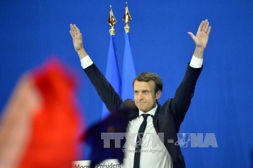 ຜູ້ອອກສະໝັກຮັບເລືອກຕັ້ງ Macron ແລະ Le Pen ຈະກ້າວເຂົ້າຮອບທີ 2 - ảnh 1