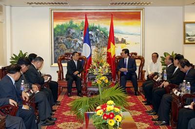 Sekjen Nguyen Phu Trong  dan PM Nguyen Tan Dung menerima Deputi PM, Menlu  Laos Thongloun Sisoulith - ảnh 2