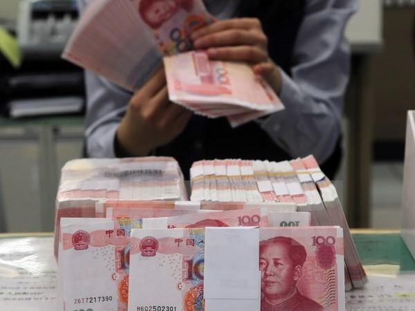 Tiongkok gigih membela kepentingan-kepentingan dalam hubungan perdagangan dengan AS - ảnh 1