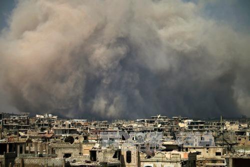 Masalah anti-terorisme: Pasukan koalisi memperhebat operasi di Irak dan Suriah - ảnh 1