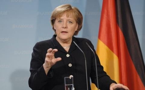 Kanselir Jerman, Angela Merkel menegaskan akan tidak memangkas kesejahteraan sosial untuk meningkatkan belanja pertahanan - ảnh 1