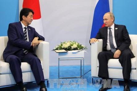 Jepang  dan Rusia sepakat bekerjasama  erat tentang masalah RDRK - ảnh 1