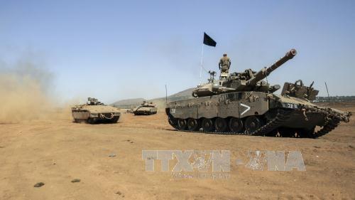 Israel melepaskan tembakan peringatan  terhadap satu pangkalan tentara Suriah - ảnh 1