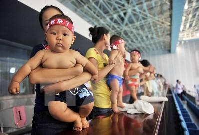 中国の人口、2020年に14億2000万人ほどに - ảnh 1