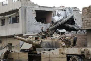イラク警察、モスルでの戦闘で化学兵器使用とISを非難 - ảnh 1