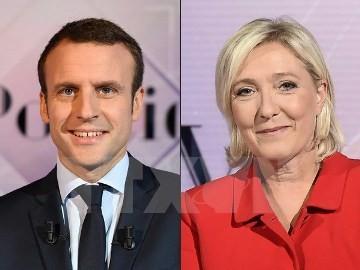 仏大統領選の決選投票、マクロン氏敗北の可能性低い=アムンディ - ảnh 1