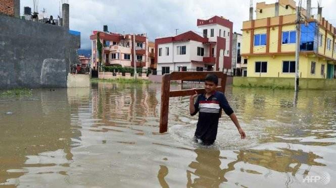 雨期の豪雨245人死亡…3か国で数百万人避難 - ảnh 1
