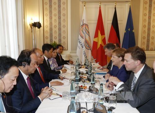 PM Nguyen Xuan Phuc menegaskan arti penting kerjasama menghadapi perubahan iklim di depan KTT G-20 - ảnh 1