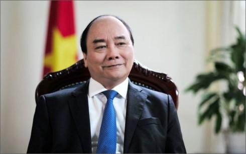 PM Nguyen Xuan Phuc tiba di Amsterdam memulai kunjungan di Belanda - ảnh 1