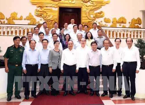 PM Nguyen Xuan Phuc: Menciptakan mekanisme khusus kepada Kota Ho Chi Minh untuk berkembang - ảnh 1