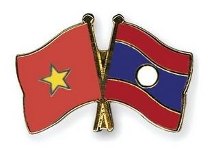 Vietnam dan Laos bertukar pengalaman tentang pekerjaan keagamaan - ảnh 1