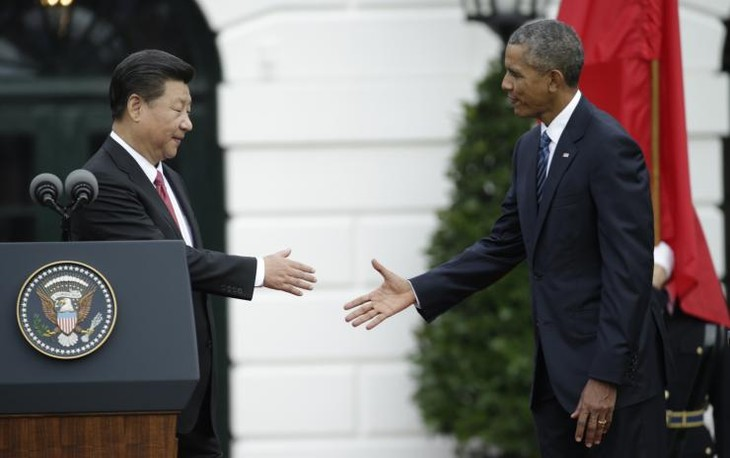 US, China reach anti-hacking and climate change agreement - ảnh 1