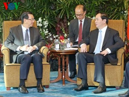 President Quang receives leaders of Singapore's major groups - ảnh 1