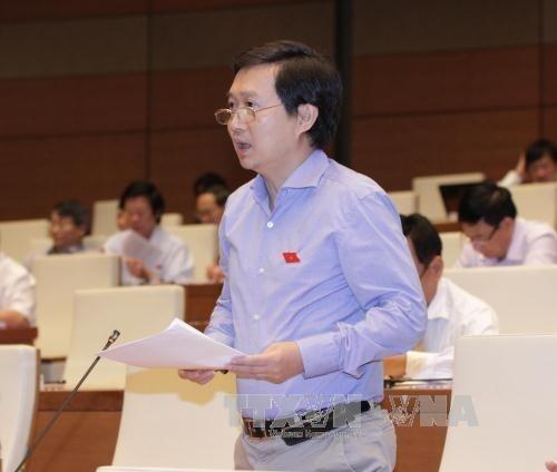 国会議員ら、第12回党大会に提出される大会議案に賛成 - ảnh 1