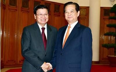 越南政府总理阮晋勇会见老挝副总理兼外长通伦•西苏里 - ảnh 1