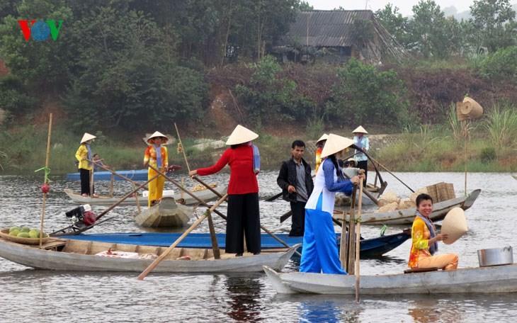 在河内越南民族旅游文化村再现南方水上集市文化 - ảnh 2