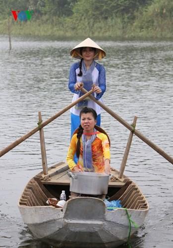 在河内越南民族旅游文化村再现南方水上集市文化 - ảnh 4