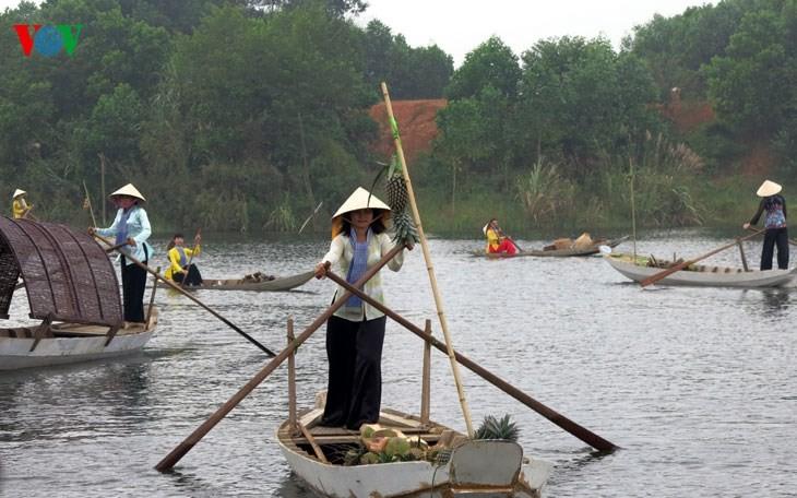 在河内越南民族旅游文化村再现南方水上集市文化 - ảnh 6