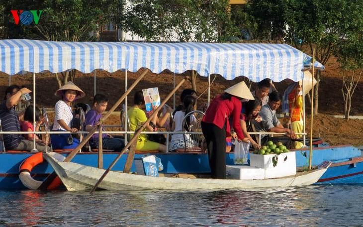 在河内越南民族旅游文化村再现南方水上集市文化 - ảnh 8