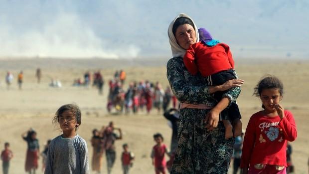 The migrant crisis: Canada parliament allows asylum for Yazidi refugees - ảnh 1