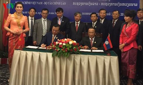 越南财政部与老挝财政部加强合作 - ảnh 1