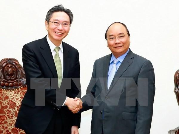 越南政府总理阮春福会见日本三菱东京日联银行总裁小山田隆 - ảnh 1