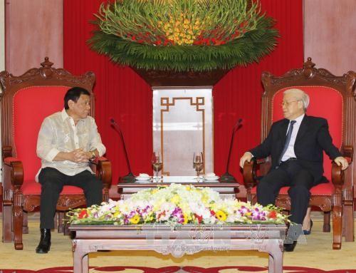 越共中央总书记阮富仲会见菲律宾总统杜特尔特 - ảnh 1