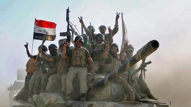 Les forces irakiennes reprennent trois quartiers du fief jihadiste de Tal Afar - ảnh 1