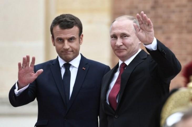 """RPDC : Poutine et Macron appellent à des """"négociations directes"""" pour baisser les tensions - ảnh 1"""